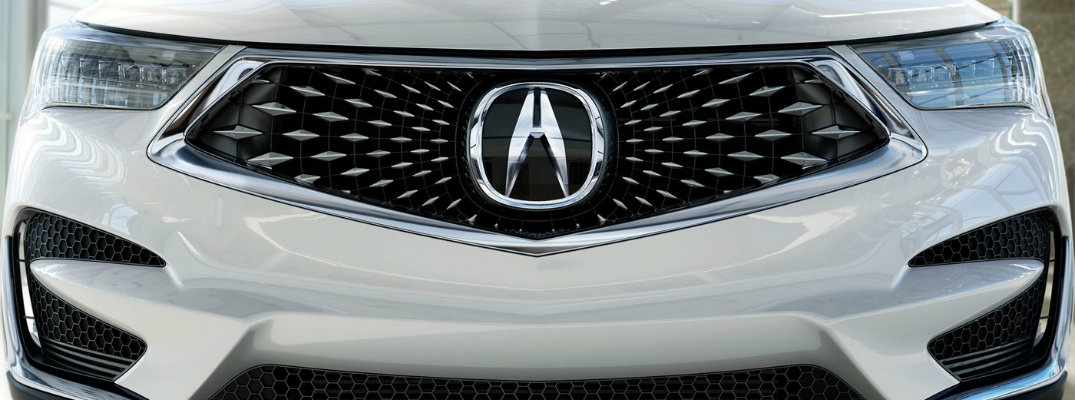 Front grille and headlights of white 2019 Acura RDX