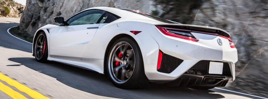 White 2019 Acura NSX driving on mountainous road