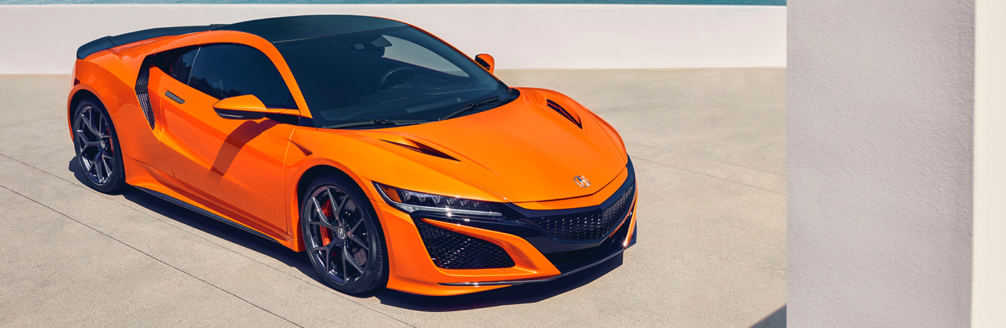 orange acura nsx on pavement