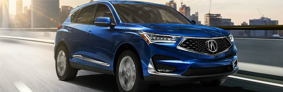 2020 Acura RDX driving away from a city