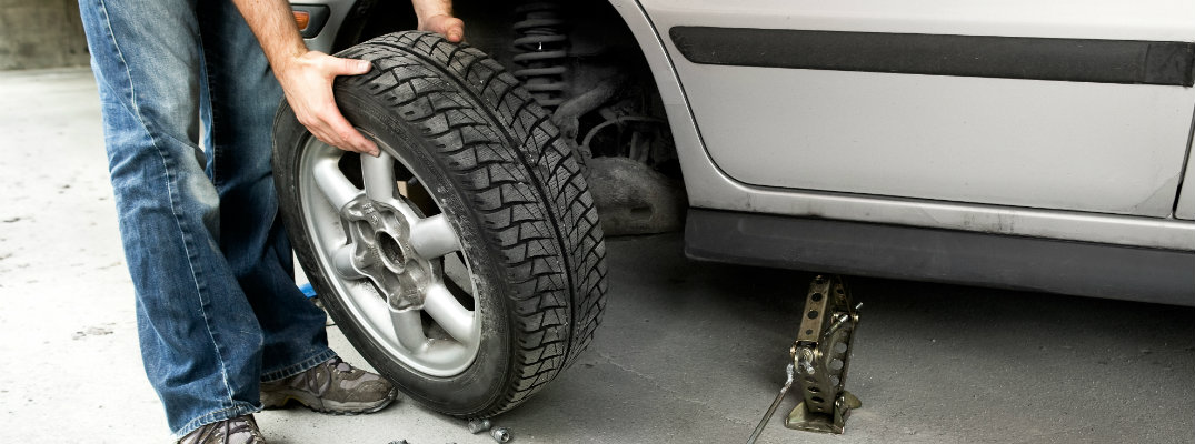 Car tire being changed