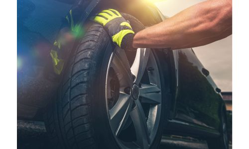 Car tire being serviced