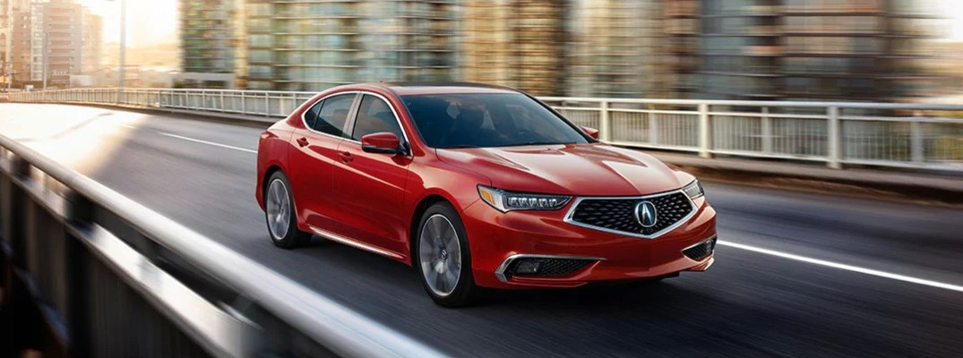 2020 Acura TLX SH-AWD advance package red color driving across city bridge featured image