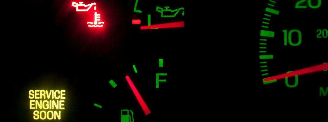 Close Up of Vehicle Dashboard with check engine light, low oil pressure light and coolant temperature light