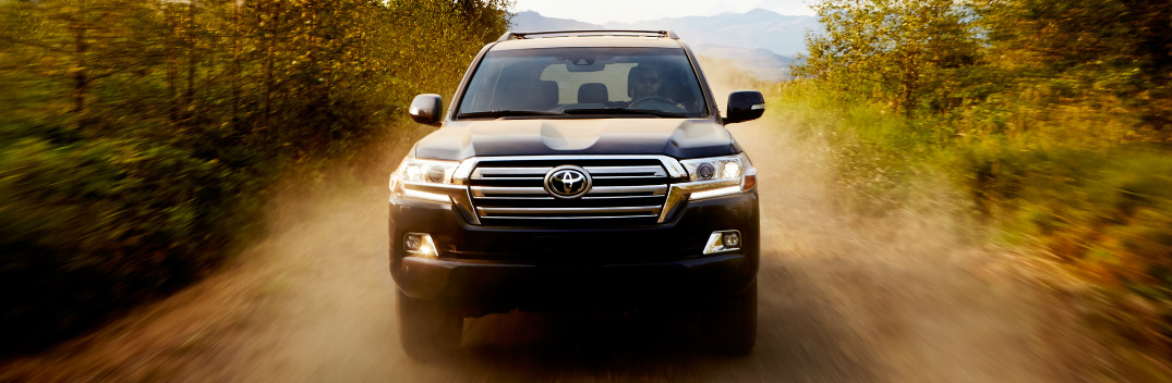 Black 2018 Toyota Land Cruiser Driving on a Dirt Road