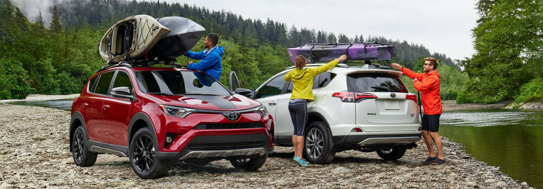 People Loading Kayaks onto 2018 Toyota RAV4 Adventure Vehicles