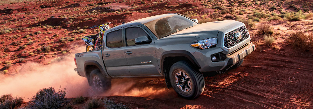 Grey 2018 Toyota Tacoma Driving on a Dirt Road
