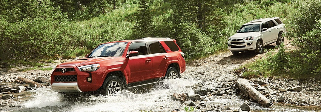 Two 2018 Toyota 4Runner Vehicles Driving Across a Stream