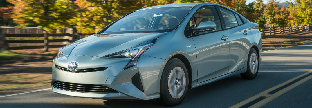 Silver 2018 Toyota Prius Driving on a Country Road