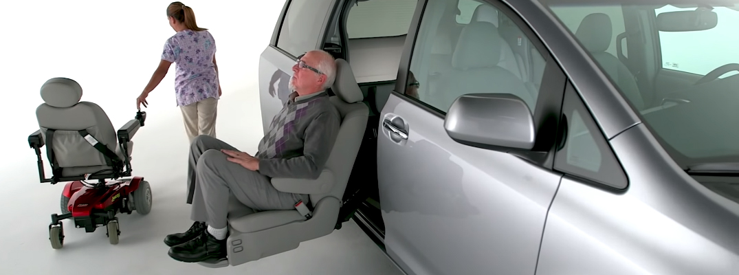 Man Sitting in the Toyota Sienna Auto Access Seat