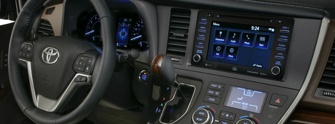 A close up photo of the dashboard in the 2018 Toyota Sienna and its technology.