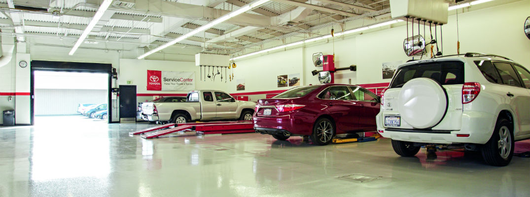 A stock photo of service bays at a Toyota dealership, similar to the one at Colonial Toyota.