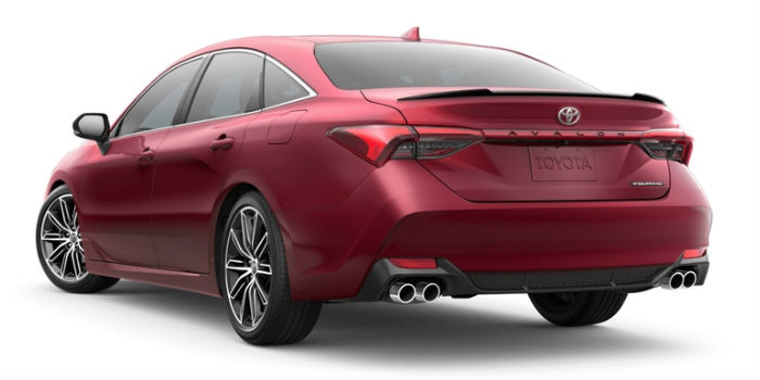 A rear left quarter photo of the 2019 Avalon in Ruby Flare Pearl.