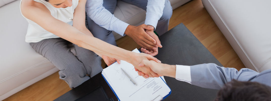 A stock photo of people shaking hands after completing a transaction.