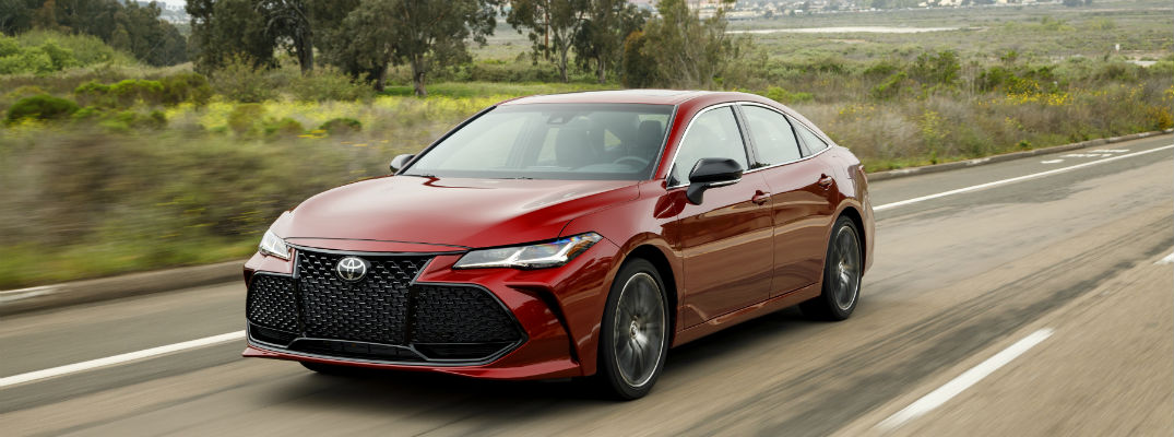 A front left photo of the 2019 Toyota Avalon on the road.