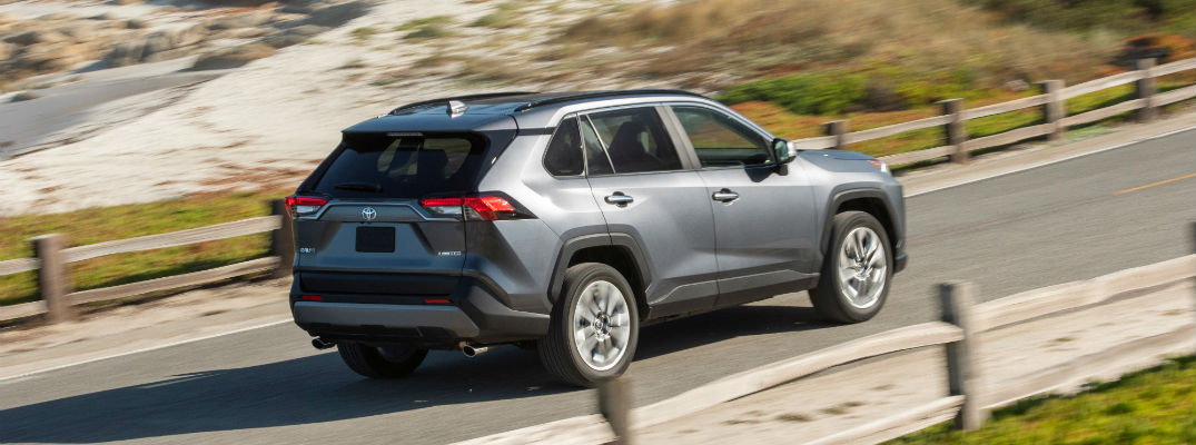A left profile photo of the 2019 Toyota RAV4 on the road.