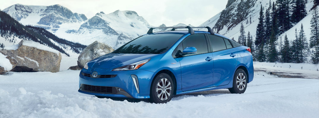 A left profile photo of the 2019 Toyota Prius parked in the snow.