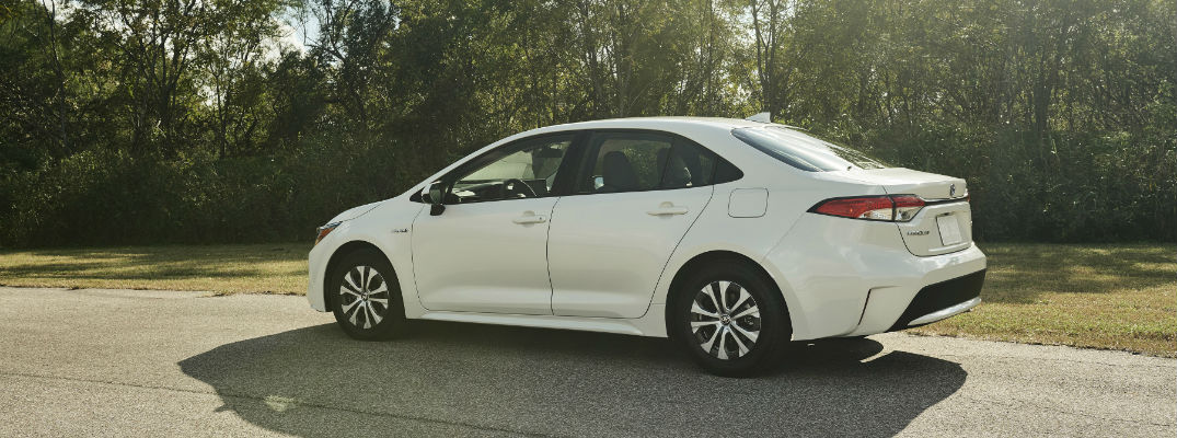 A left profile photo of the 2020 Toyota Corolla parked on the road.