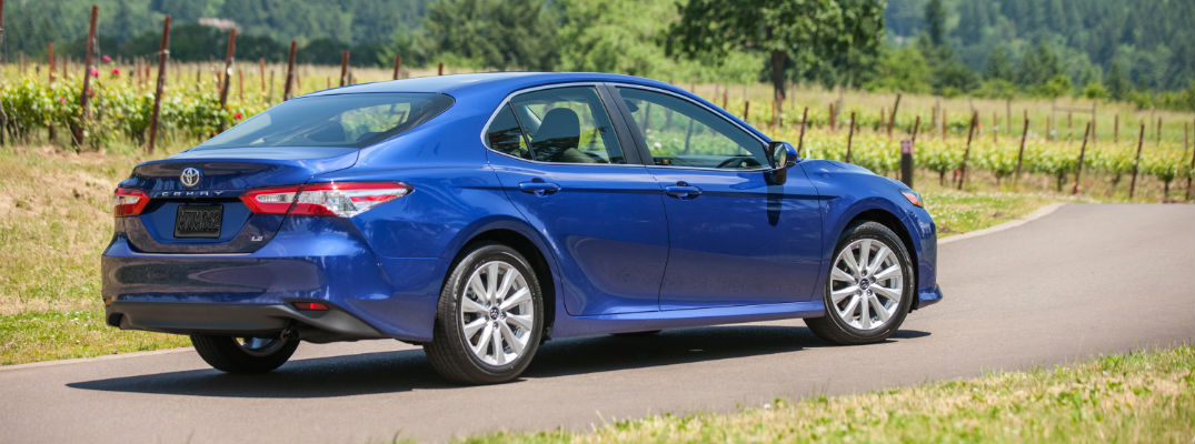 A right profile photo of a 2019 Toyota Camry parked on the road.