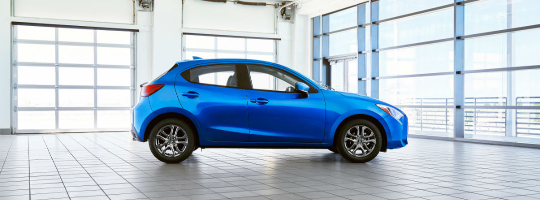 A right profile photo of the 2020 Toyota Yaris Hatchback in a garage.
