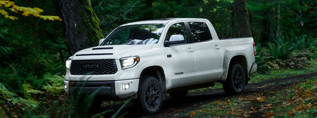 A photo of the 2020 Toyota Tundra TRD Pro driving through the woods.