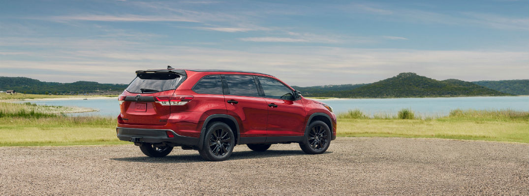 A photo of the 2019 Toyota Highlander parked by a lake.