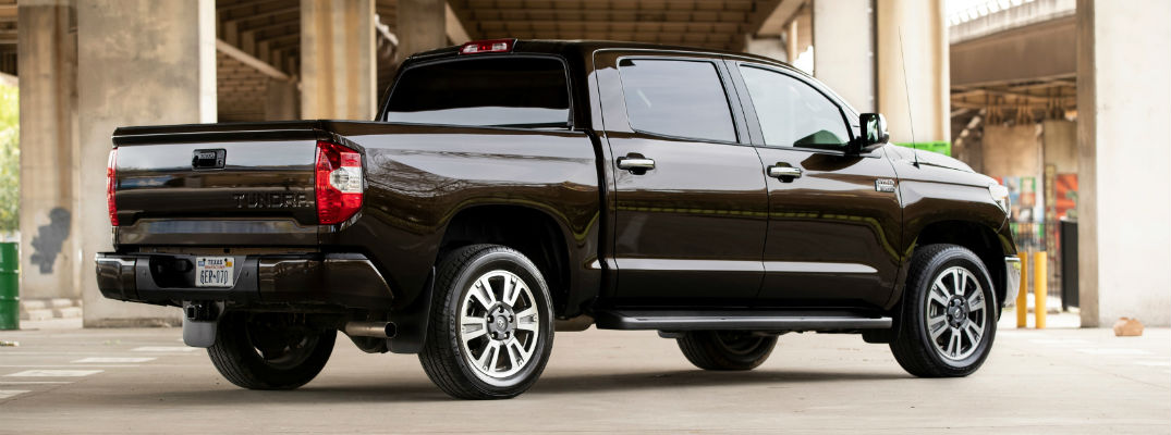 A right profile photo of a Toyota Tundra parked on the road.
