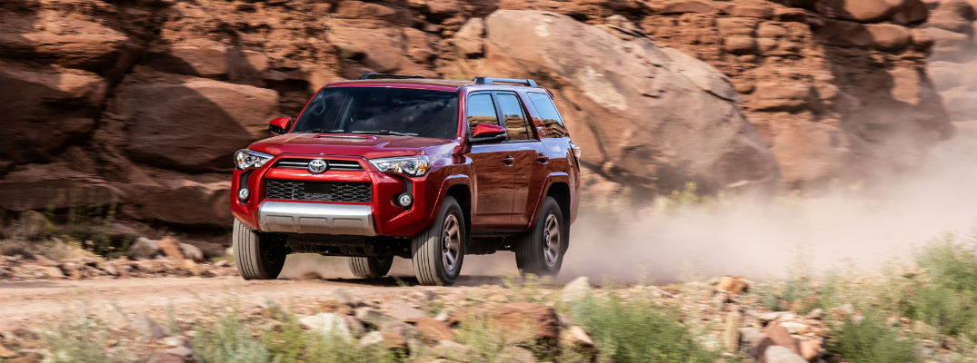 A photo of the 2020 Toyota 4Runner driving on a desert road.