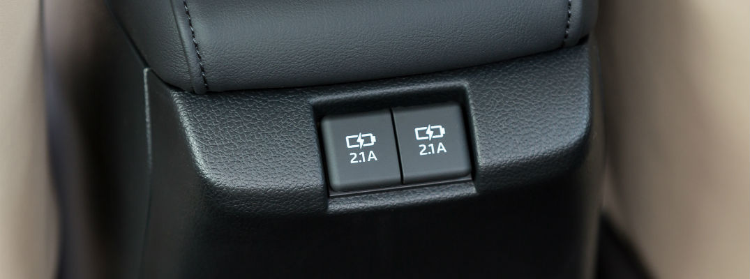 A photo of the USB charging ports in the back seat of a Toyota vehicle.