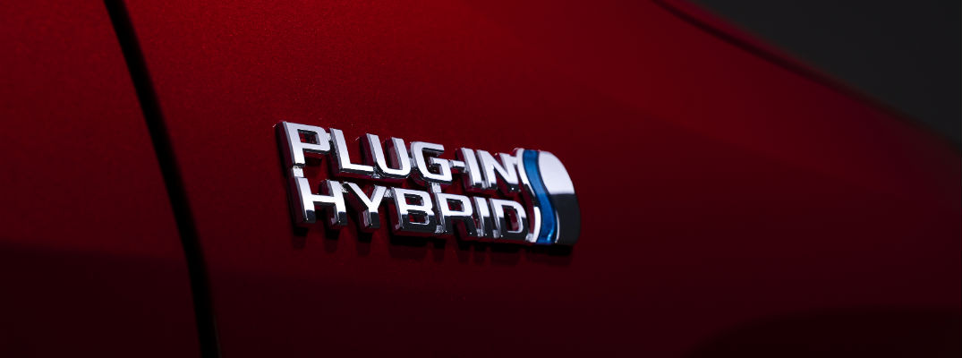 A photo of the Plug-In Hybrid badge worn by the 2021 Toyota RAV4 Prime.