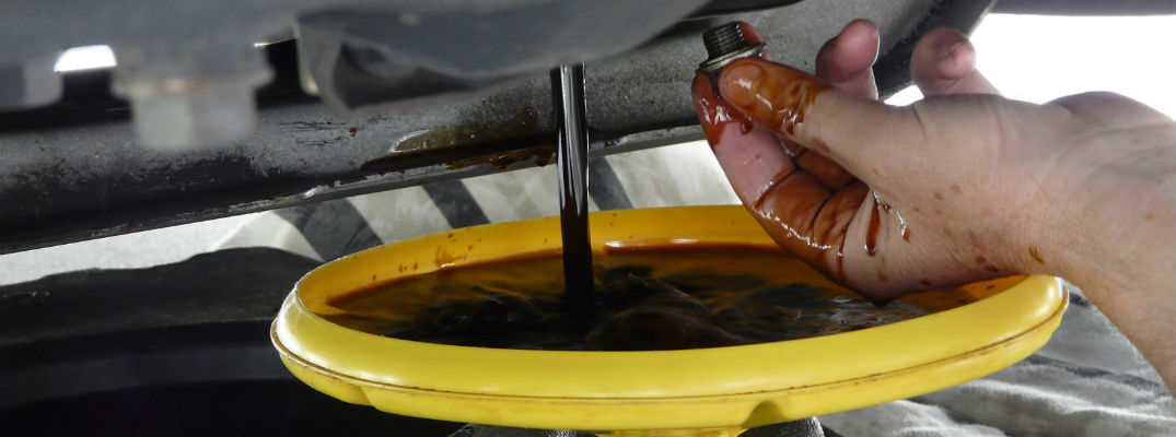 A stock photo of oil draining from an engine.