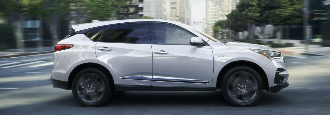 Side profile of 2019 Acura RDX driving through city