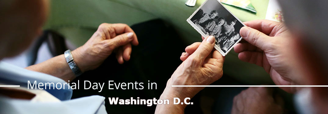 Elderly couple gazing at old photo with text saying Memorial Day Events in Washington D.C.