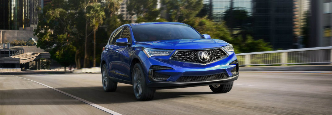 Blue 2019 Acura RDX driving down freeway