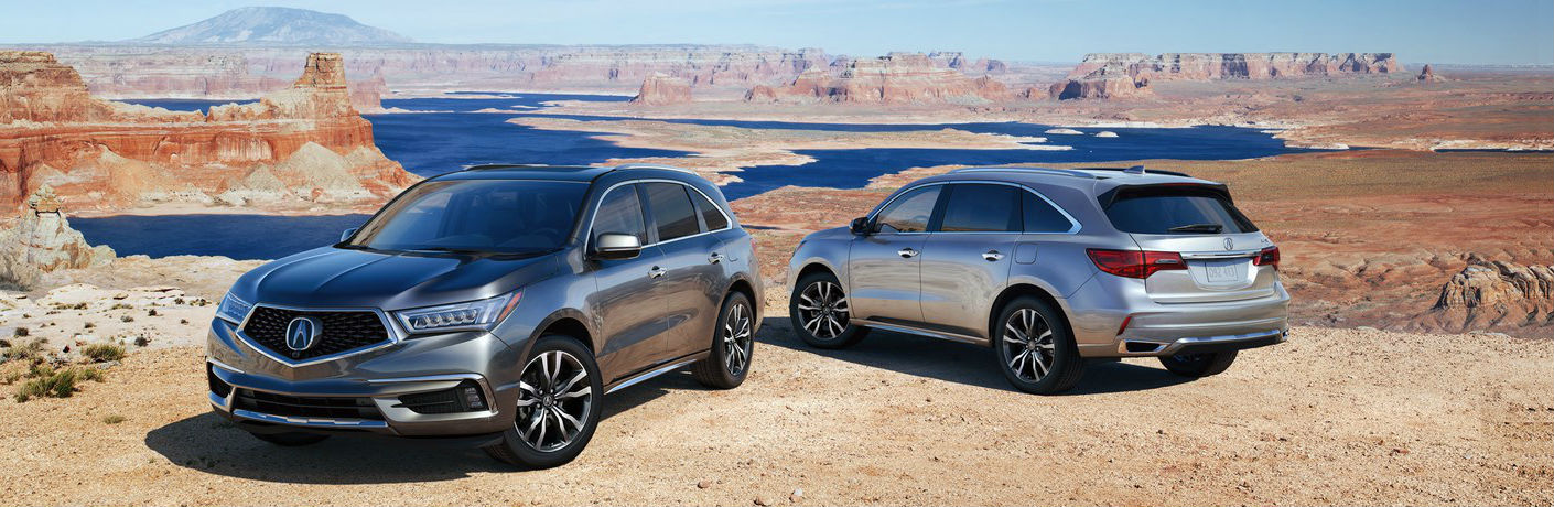 Two 2019 Acura MDX Advance models parked in Utah