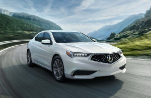 white acura 2019 tlx on road with hills in background