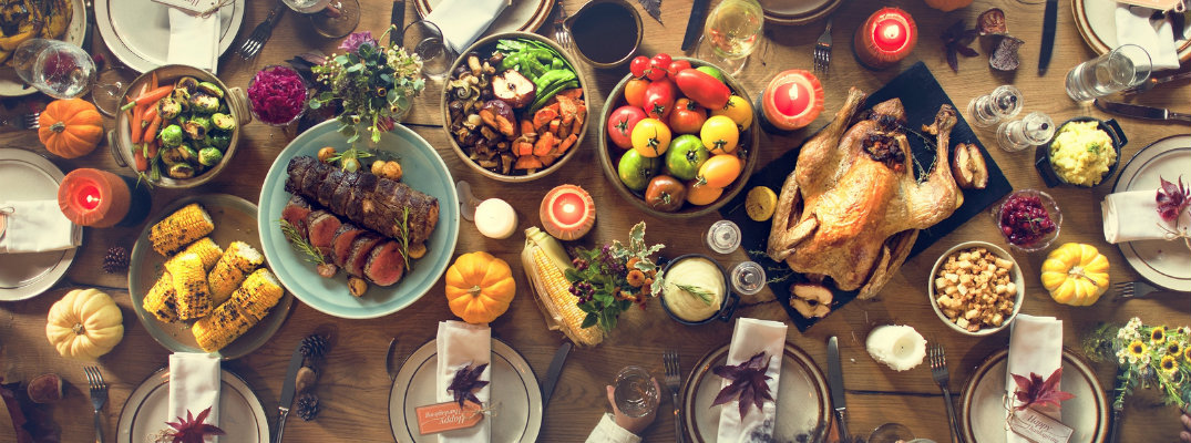 Thanksgiving table full of traditional foods