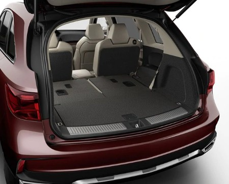 Rear driver angle of the 2020 Acura MDX with the third row of seats down