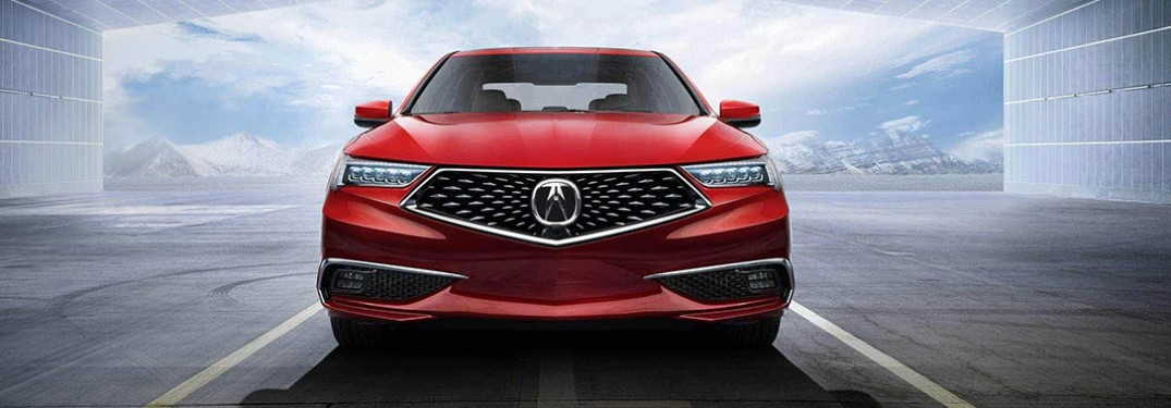 Front angle of a red 2020 Acura TLX parked in an open building