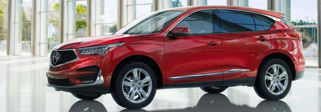 Front driver angle of a red 2020 Acura RDX Advance Package