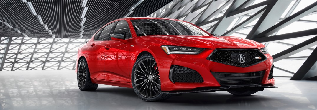 Front passenger angle of a red 2021 Acura TLX Type S