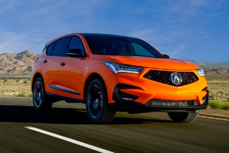 Front passenger angle of an orange 2021 Acura RDX PMC Edition