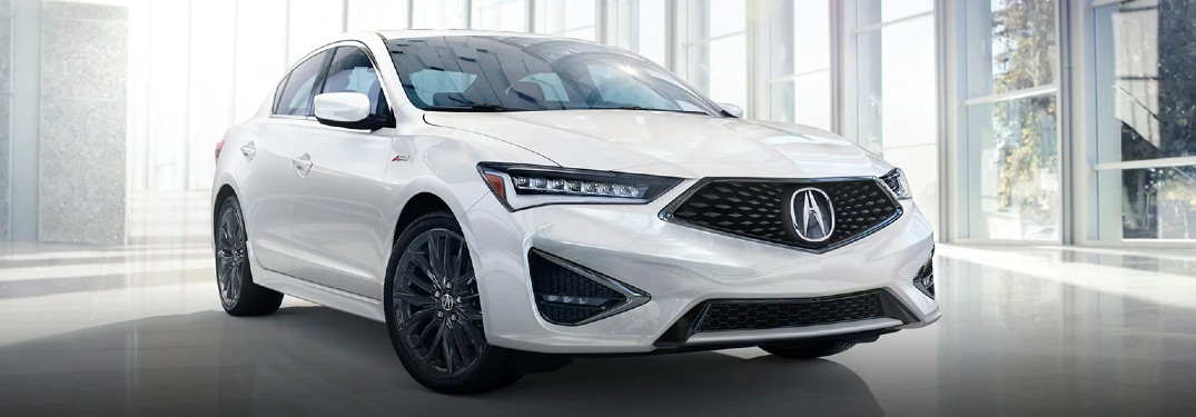Front passenger angle of a white 2021 Acura ILX A-Spec Package