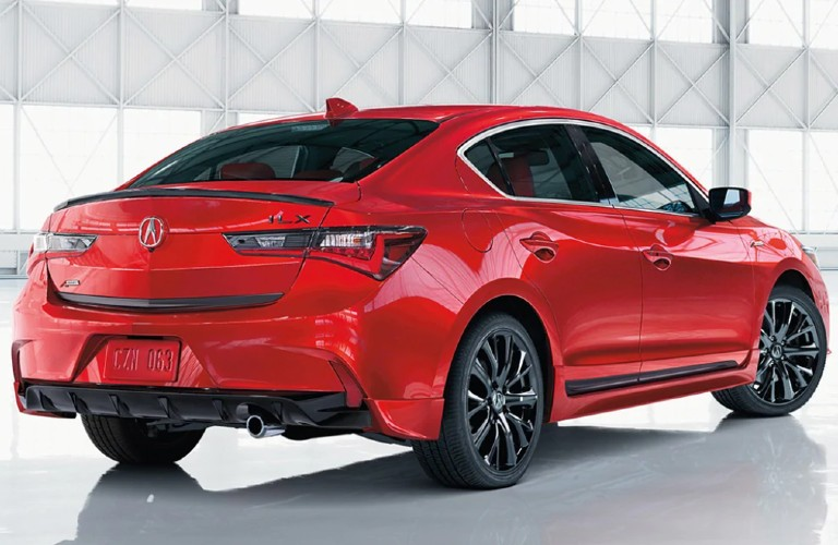 Rear passenger angle of a red 2021 Acura ILX