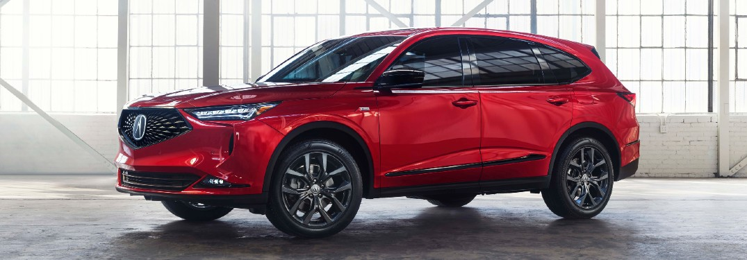 Front driver angle of a red 2022 Acura MDX