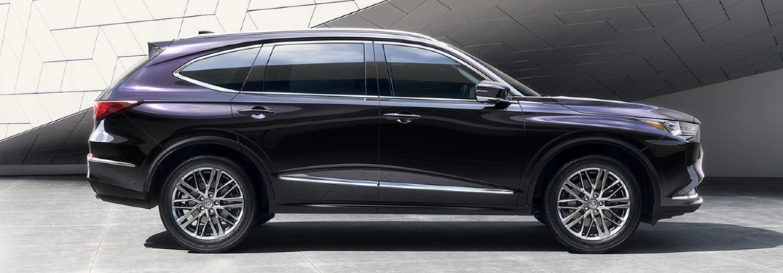 Passenger angle of a dark grey 2022 Acura MDX