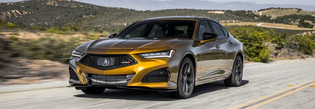 Front driver angle of a gold 2021 Acura TLX Type S
