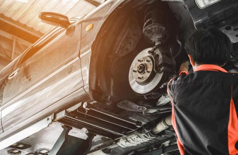 Mechanic replacing the brakes in a car