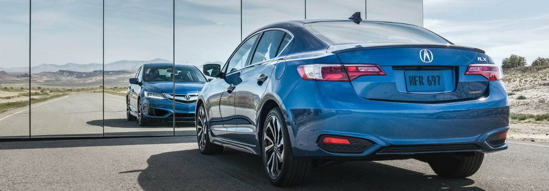 Rear view of the 2018 Acura ILX facing mirrored panels that reflect the front end