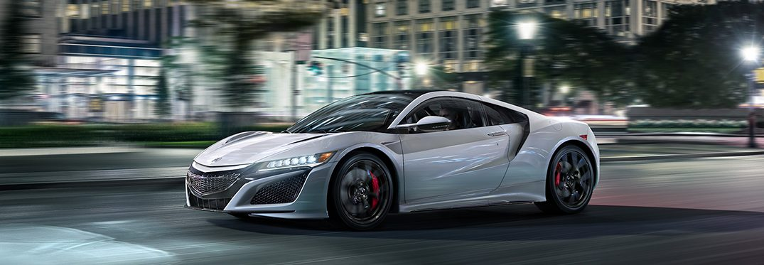 full view of the acura nsx driving in a city